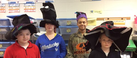 Art students celebrating Art Month with creative hats!
